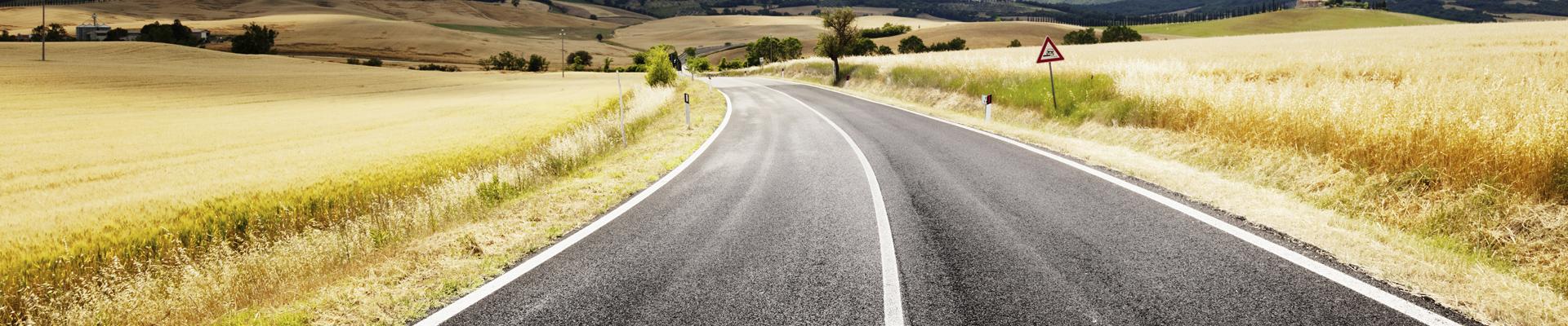 road-through-grass-rolling-hills